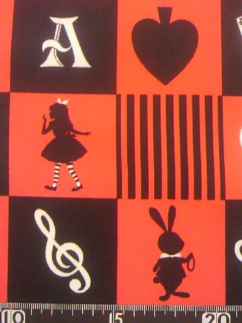 アリス柄の布地