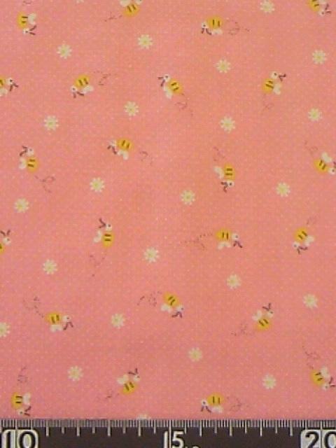 ピンク地ハチ柄の布地