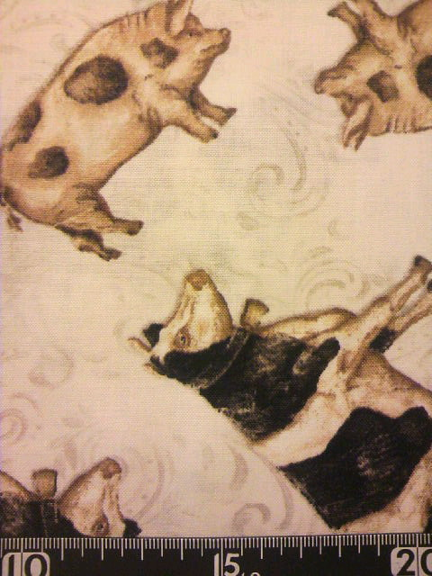 ウシとブタ柄の布地