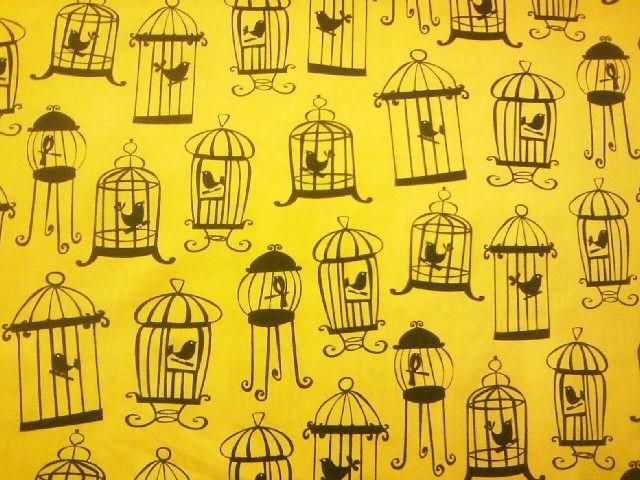 鳥と鳥かご柄の布地