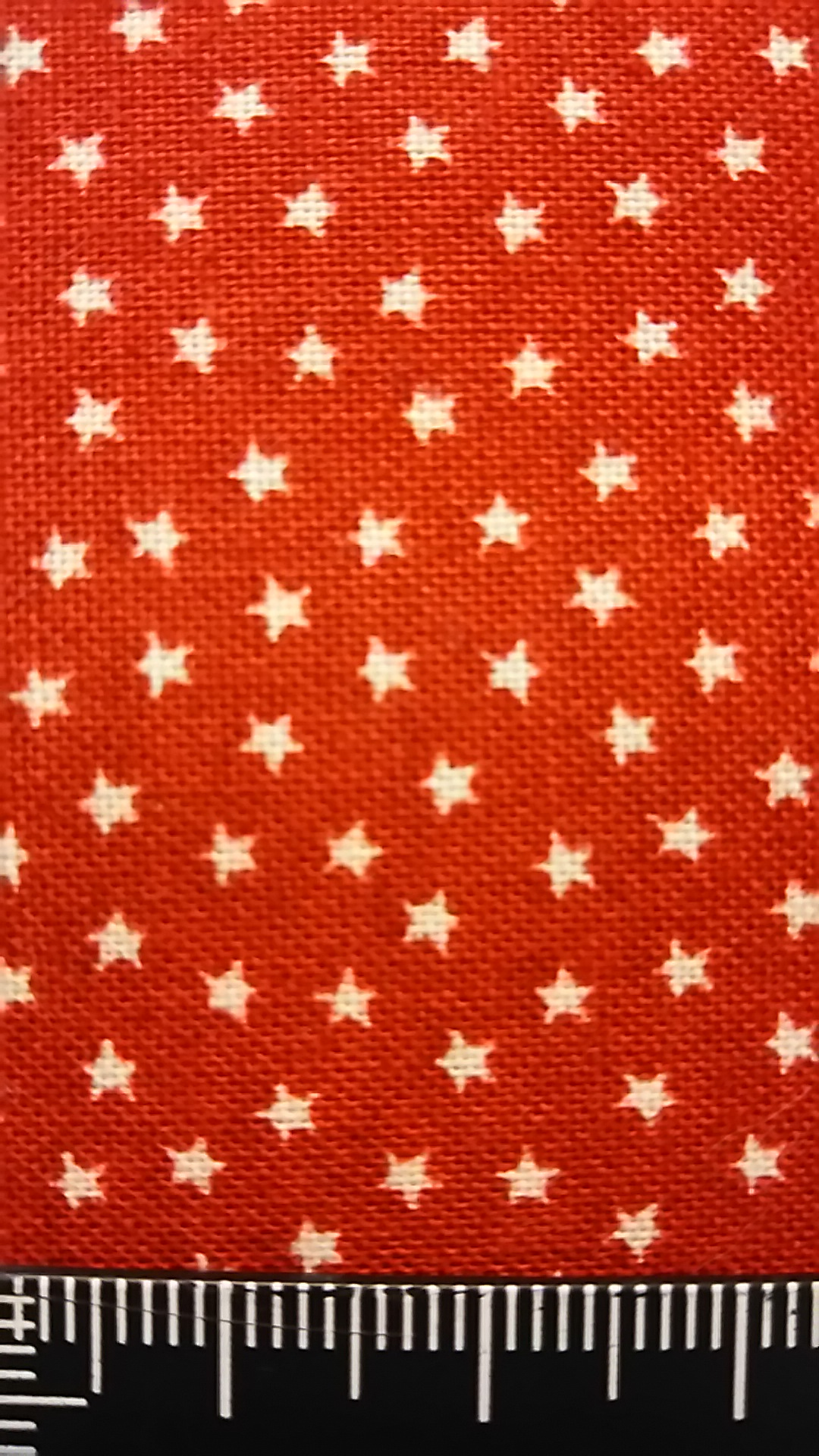 赤地星柄の布地